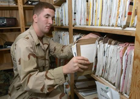http://upload.wikimedia.org/wikipedia/commons/8/86/US_Navy_061030-N-1328C-061_U.S._Navy_Hospital_Corpsman_Joseph_Malandro_from_Haddon_Township,_N.J.,_files_medical_records_at_the_Michaud_Medical-Dental_Facility.jpg